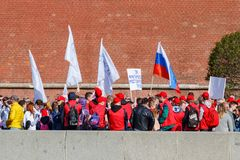 Moscow, Russia - May 01, 2019: Peoples with flags and banners on Kremlevskaya embankment go to the May Day demonstration on Red royalty free stock photo
