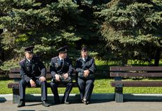 Moscow,Russia, May 9, 2018: police officers sitting on a bench in sunny day stock photo