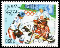 Ice hockey, Olympic Games 1988 - Calgary serie, circa 1988. MOSCOW, RUSSIA - MAY 25, 2019: Postage stamp printed in Kampuchea Cambodia shows Ice hockey, Olympic stock photos