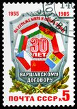 30th Anniversary of Warsaw Pact Organization, circa 1985. MOSCOW, RUSSIA - MAY 25, 2019: Postage stamp printed in Soviet Union (Russia) devoted to 30th royalty free stock image