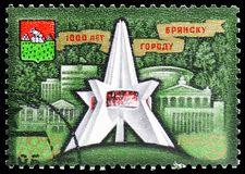 Victory Monument, Coat of Arms, Buildings, Millenary of Bryansk serie, circa 1985. MOSCOW, RUSSIA - MAY 25, 2019: Postage stamp printed in Soviet Union (Russia) royalty free stock photo