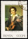 Guitarist, 1832, V.A.Tropinin 1776-1856, Russian Paintings serie, circa 1973. MOSCOW, RUSSIA - MAY 25, 2019: Postage stamp printed in Soviet Union shows ` royalty free stock image