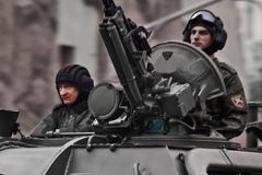 A stern tankman and a machine gunner on the tower of his car. Moscow / Russia - May 6, 2018: Rehearsal of the parade dedicated to victory in the Second World War royalty free stock photo