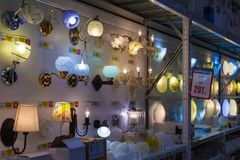 A row of wall sconce lamps in store stock image