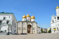 Moscow, Russia, May,19,2014. Russian scene: people walking near Uspensky Cathedral in Moscow kremlin Royalty Free Stock Images