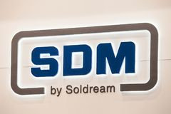 SDM Soldream logo sign banner. SDM is the leading supplier of high-level metalworking equipment. Moscow, Russia - May, 2017: SDM Soldream logo sign banner. SDM Stock Photography