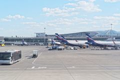 Infrastructure at Sheremetyevo international airport. airplanes waiting on terminal gates for passenger. Airport bus is bringing p stock photos