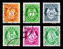 Six postage stamps printed in Norway from Post horn serie (1910-1969). MOSCOW, RUSSIA - MAY 13, 2018: Six postage stamps printed in Norway shows Post horn - New stock photo