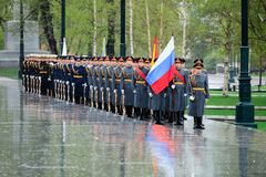 MOSCOW, RUSSIA - MAY 08, 2017: Soldiers of The Honor Guard of the 154 Preobrazhensky Regiment. Rainy and snowy view. Alexander Ga. MOSCOW, RUSSIA - MAY 08, 2017 Stock Photos