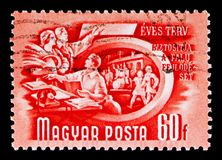 Agricultural cooperation, Five-Year Plan serie, circa 1950. MOSCOW, RUSSIA - MAY 16, 2018: A stamp printed in Hungary shows Agricultural cooperation, Five-Year stock photos