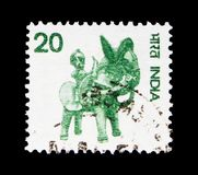 Horse with rider, Country Motifs serie, circa 1975. MOSCOW, RUSSIA - MAY 13, 2018: A stamp printed in India shows Horse with rider, Country Motifs serie, circa stock images
