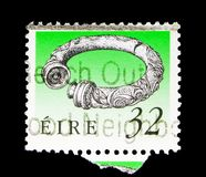 Broighter Collar (1st Cty. BC), Irish Heritage and Treasures 199. MOSCOW, RUSSIA - MAY 13, 2018: A stamp printed in Ireland shows Broighter Collar &# Stock Photo