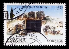 Menga cave, Malaga, Archaeology serie, circa 1995. MOSCOW, RUSSIA - MAY 10, 2018: A stamp printed in Spain shows Menga cave, Malaga, Archaeology serie, circa royalty free illustration