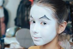 Portrait of a little girl in clown makeup. stock photos