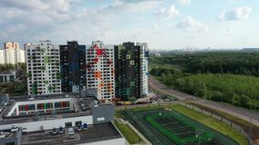 Residential area. MOSCOW, RUSSIA - MAY 26, 2019: Top view of the new colorful residential area of Moscow on a summer evening stock footage