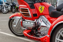 Moscow, Russia - May 04, 2019: Tourist trike Honda Gold Wing in bright red plastic body kit and chromed engine in the parking. Closeup. Moto festival royalty free stock photography