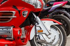 Moscow, Russia - May 04, 2019: Tourist trike Honda Gold Wing in bright red plastic body kit in the parking closeup. Moto festival. MosMotoFest 2019 stock photography