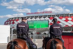 Moscow, Russia - May 30, 2018: The two policemen on horses of the entrance provide the security on Spartak Stadium. royalty free stock photo