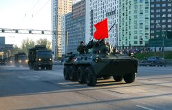 Around the city the BTR-82A armored personnel carrier with 30-mm gun 2A72 and a red flag goes. Moscow. Russia. May 3, 2017. The Victory Day parade rehearsal for stock image