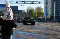 Around the city the armored recovery vehicle BREM-1 goes. Moscow. Russia. May 3, 2017. The Victory Day parade rehearsal for May 9. The daughter sits on necks of stock photos