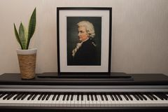 Mozart portrait on the piano. A composition of the composer portrait on the piano keyboard.