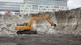Moscow. Russia. News. Today. Snow cleaning spring export. The excavator destroys the snow mountain. Consequences of a multi-day sn. Owfall. Outdoor. City stock footage