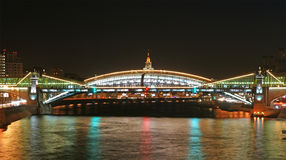 Moscow, Russia. Night. View from the embankment of the Moskva River on the pedestrian bridge Bogdan Khmelnitsky Stock Photos