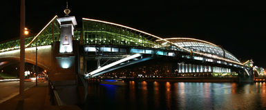 Moscow, Russia. Night. Panoramic view. From the embankment of the Moskva River. Pedestrian bridge Bogdan Khmelnitsky Stock Photos
