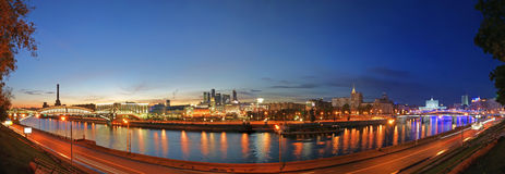 Moscow, Russia. Night. Panoramic view. From the embankment of the Moskva River in the Kievsky train station, international business centre and bridges Royalty Free Stock Images