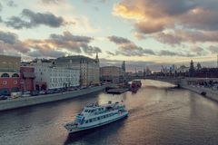Beautiful sunset over Moskva river and a touristic boat cruising stock photos