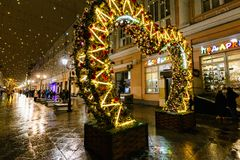MOSCOW, RUSSIA - NOVEMBER 4, 2016: Christmas and New Year street decoration, people walking, street lights and snow. Stock Photo