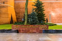 Obelisk with the inscription `1941 Fallen for the Motherland 1945` near the Kremlin wall in the Alexander garden. Moscow, Russia-November, 30, 2017: Obelisk with Royalty Free Stock Image