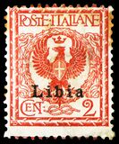 Postage stamp printed in Italy shows Eagle and ornaments, overprint Libia, Floreal serie, 2 Italian centesimo, circa 1901