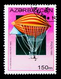 Tissandier brothers electrically-powered airship, 1883, History. MOSCOW, RUSSIA - NOVEMBER 26, 2017: A stamp printed in Azerbaijan shows Tissandier brothers Royalty Free Stock Photography