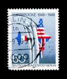 Airlift Memorial, allied US & UK flags forming airplane, Berlin. MOSCOW, RUSSIA - NOVEMBER 26, 2017: A stamp printed in Berlin shows Airlift Memorial, allied US royalty free stock photos