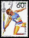 Javelin Throw, OLYMPHILEX '90, Varna, serie, circa 1990. MOSCOW, RUSSIA - NOVEMBER 10, 2018: A stamp printed in Bulgaria shows Javelin Throw, OLYMPHILEX royalty free stock images