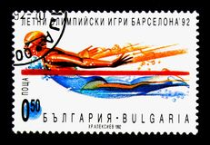 Swimming, Summer Olympic Games 1992, Barcelona (I) serie, circa. MOSCOW, RUSSIA - NOVEMBER 25, 2017: A stamp printed in Bulgaria shows Swimming, Summer Royalty Free Stock Image