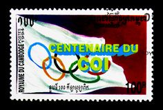 Olympic flag, 100 year of the International Olympic Commettee serie, circa 1994. MOSCOW, RUSSIA - NOVEMBER 24, 2017: A stamp printed in Cambodia shows Olympic royalty free stock photos