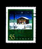Christmas Creche, by Michel Guilemette, Christmas (2000), Nativi. MOSCOW, RUSSIA - NOVEMBER 26, 2017: A stamp printed in Canada shows Christmas Creche stock photo