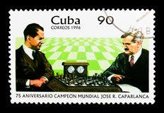 In championship match Jose Capablanca against Em. Lasker, World. MOSCOW, RUSSIA - NOVEMBER 25, 2017: A stamp printed in Cuba shows In championship match Jose Royalty Free Stock Photos