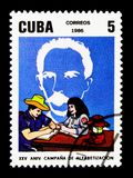 Marti, man learning to write, National Literacy Campaign, 25th a. MOSCOW, RUSSIA - NOVEMBER 25, 2017: A stamp printed in Cuba shows Marti, man learning to write Stock Images