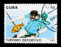 Spearfishing, Sport turism serie, circa 1990. MOSCOW, RUSSIA - NOVEMBER 25, 2017: A stamp printed in Cuba shows Spearfishing, Sport turism serie, circa 1990 Royalty Free Stock Photography