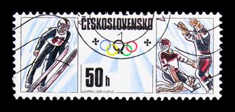 Olympic games - Ski jumping, ice hockey, Olympic Games 1988 - Ca. MOSCOW, RUSSIA - NOVEMBER 26, 2017: A stamp printed in Czechoslovakia shows Olympic games - Ski Royalty Free Stock Image