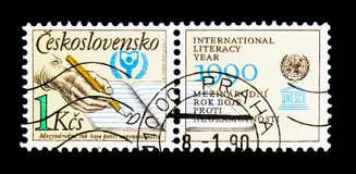 UNESCO World Literacy Year, serie, circa 1990. MOSCOW, RUSSIA - NOVEMBER 25, 2017: A stamp printed in Czechoslovakia shows UNESCO World Literacy Year, serie Stock Image