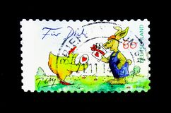 For You (The Easter Present), Cartoons by Peter Gaymann serie, c. MOSCOW, RUSSIA - NOVEMBER 26, 2017: A stamp printed in Federal Republic of Germany shows For stock image