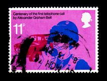 District Nurse, Telephone Centenary serie, circa 1976. MOSCOW, RUSSIA - NOVEMBER 24, 2017: A stamp printed in Great Britain shows District Nurse, Telephone Stock Photo
