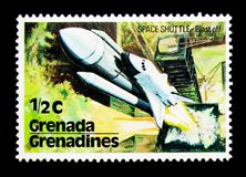 Space shuttle blast off, US Space Shuttle serie, circa 1978. MOSCOW, RUSSIA - NOVEMBER 26, 2017: A stamp printed in Grenada, Grenadines shows Space shuttle blast Stock Images
