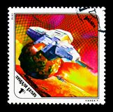 Phobos, Science Fiction Paintings by Pal Varga serie, circa 1978. MOSCOW, RUSSIA - NOVEMBER 26, 2017: A stamp printed in Hungary shows Spaceship near Phobos royalty free stock photography