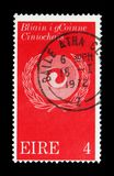 Racial Harmony symbol, Racial Equality Year serie, circa 1971. MOSCOW, RUSSIA - NOVEMBER 23, 2017: A stamp printed in Ireland shows Racial Harmony symbol, Racial Royalty Free Stock Photos