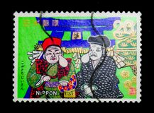 Rich and Poor Men with Wens, Folklore serie, circa 1974. MOSCOW, RUSSIA - NOVEMBER 23, 2017: A stamp printed in Japan shows Rich and Poor Men with Wens, Folklore Royalty Free Stock Photo